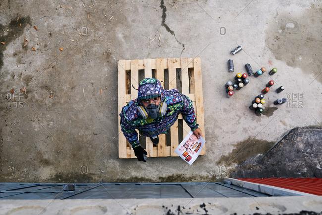 Graffiti muralist getting ready to paint