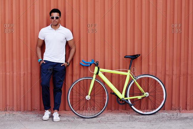 Young man posing with his bicycle