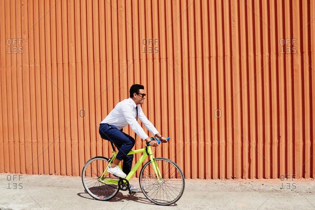Young man riding a bike