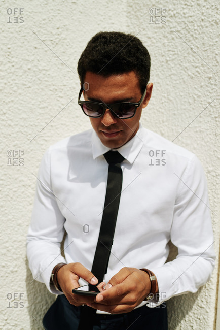 Young businessman using a smartphone