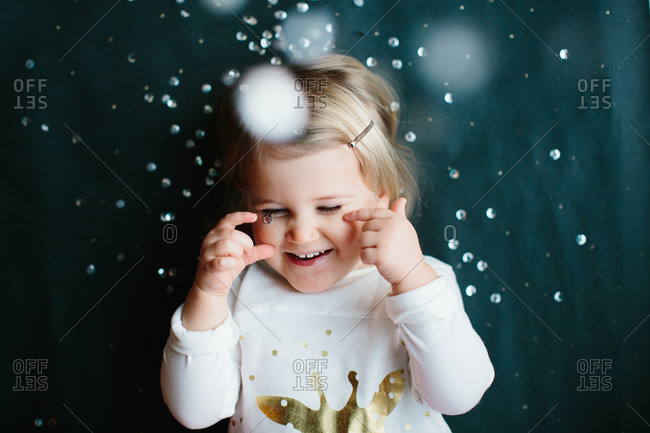 Smiling young girl with confetti