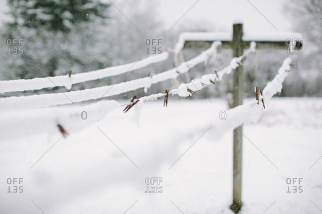 Clothespins on a clothesline in the snow