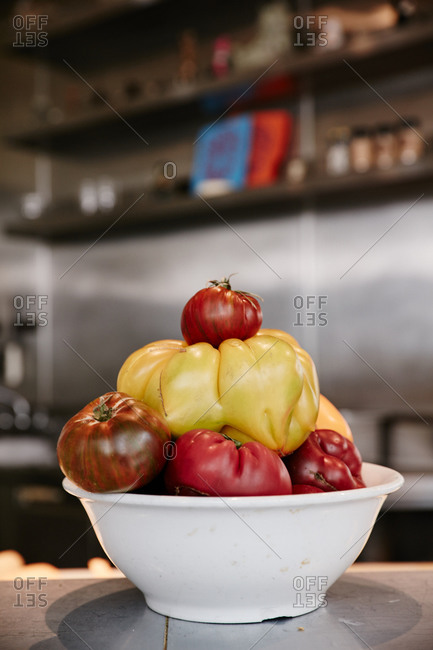 Variety of tomatoes stacked in a bowl