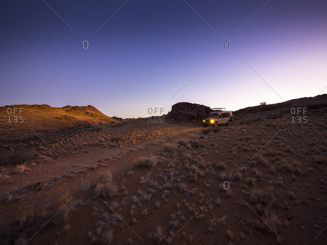 Namibia - March 13, 2015: Landrover in Kulala Wilderness Reserve at dusk