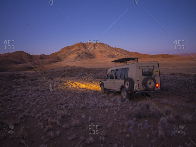 Namibia - March 13, 2015: Landrover in Kulala Wilderness Reserve in the evening
