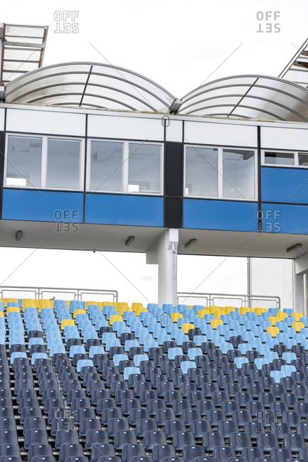 Empty grandstands and press box in stadium