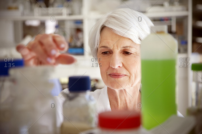 Senior woman working at chemical laboratory