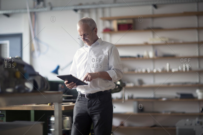 Man with digital tablet in a workshop