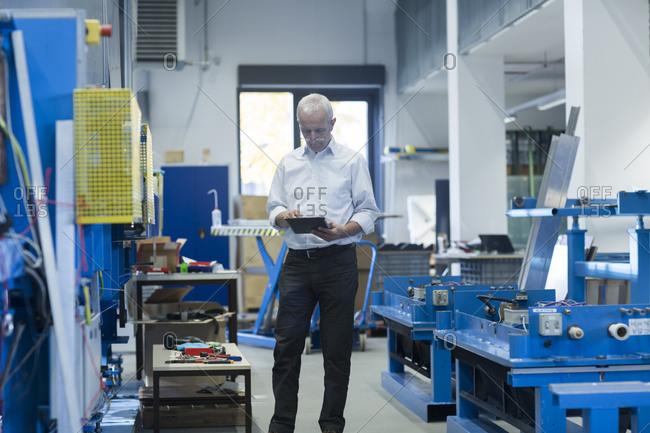 Man using digital tablet in a workshop