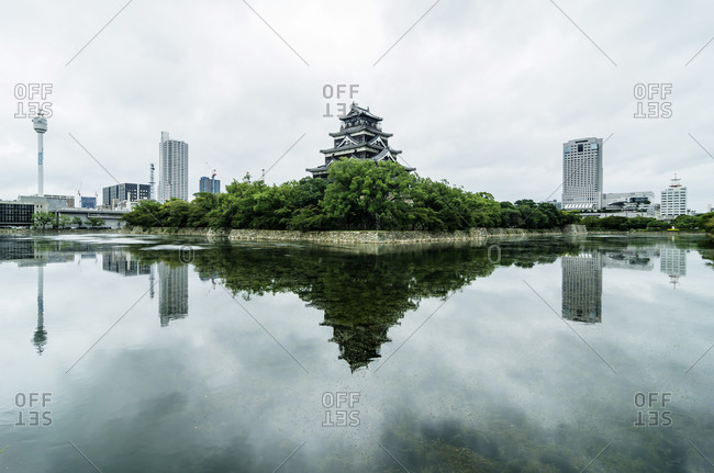 Traditional Japanese tower flanked by modern skyline