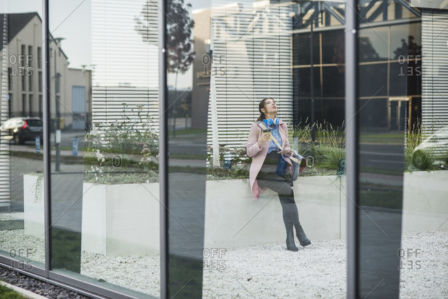 Young woman in atrium of a building
