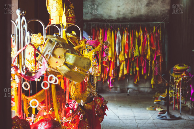 Traditional costumes hang in the palace in Hue, Vietnam