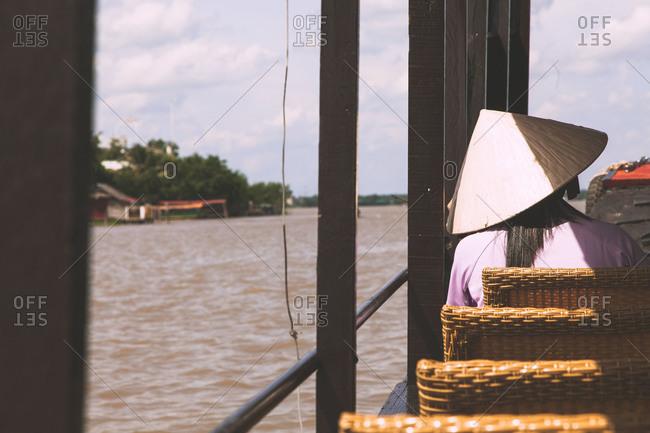 Boat travels along the Mekong Delta in Vietnam
