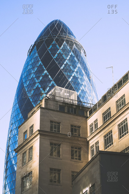 London, England, UK - October 6, 2013: The Gherkin behind an older building in London, England