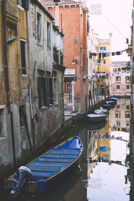 Laundry hangs above a canal in Venice, Italy