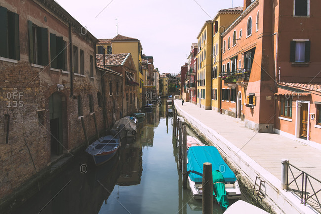 Boats line either side of a canal in Venice, Italy