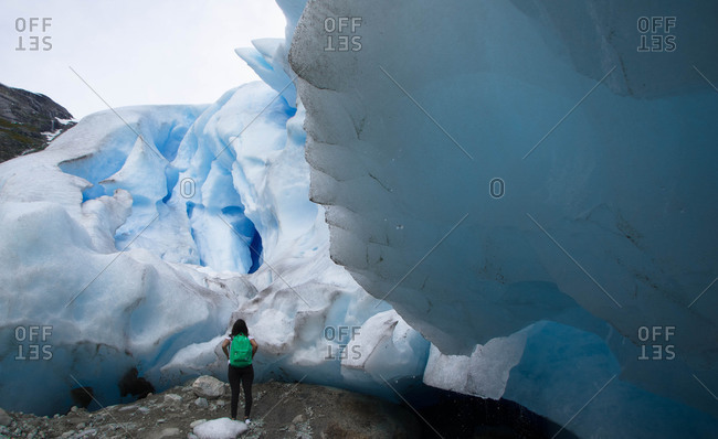 Woman looking at a glacier formation