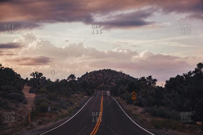 Empty highway in a hilly terrain