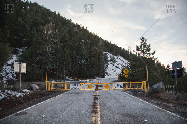 Mountain highway with road closed barrier