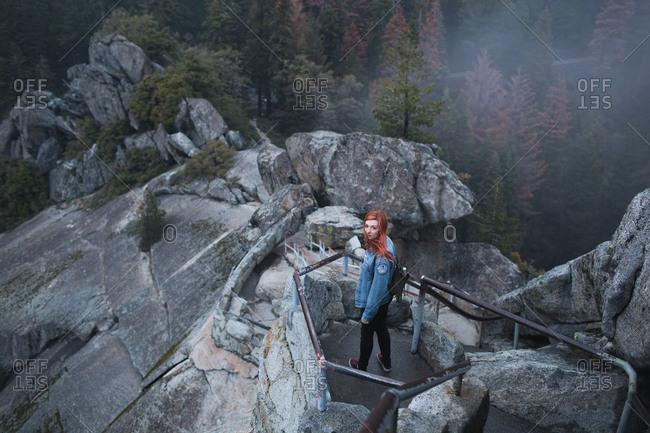 Woman on a steep mountain hiking trail