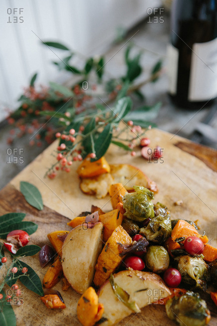 Elevated view of roasted winter vegetables with cranberries