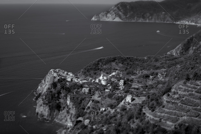 Black and white image of a village along the coast on the Italian Riviera, Liguria, Italy