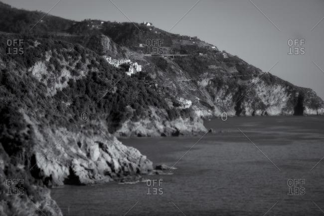Village along the coast on the Italian Riviera in black and white, Liguria, Italy