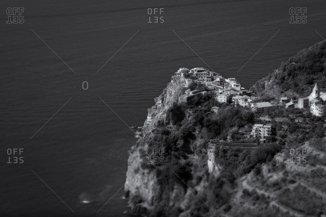 View of a village along the coast on the Italian Riviera in black and white, Liguria, Italy