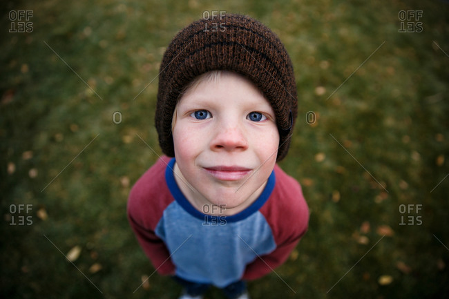 Boy in knit cap and long sleeved t-shirt