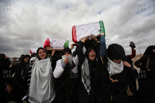 Ahwaz, Iran - March 11, 2014: People during a funeral of Iranian martyrs