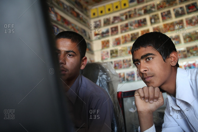 Zabol, Iran - May 1, 2014: Two boys watching a computer screen