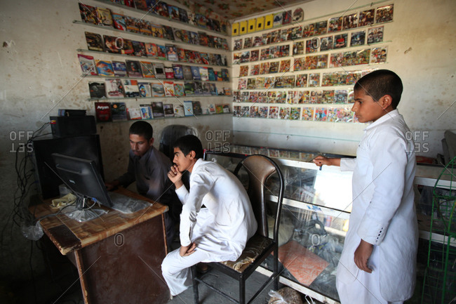 Zabol, Iran - April 5, 2014: Boys playing computer games in a store