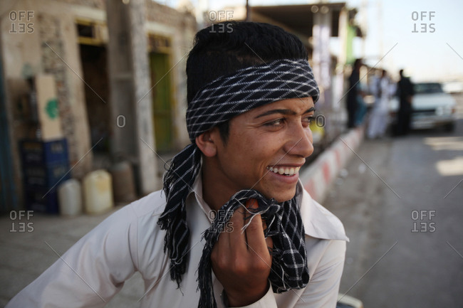 Zabol, Iran - May 1, 2014: Young man laughing in the street