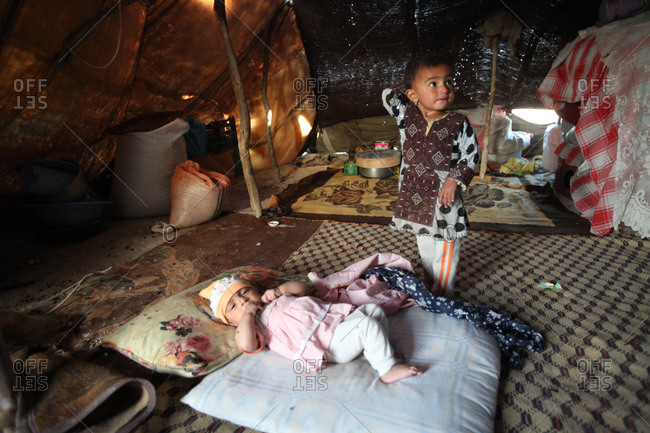 Two little kids in a tent in south Iran