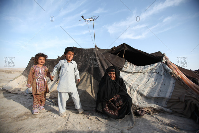 People outside a tent in Iran desert