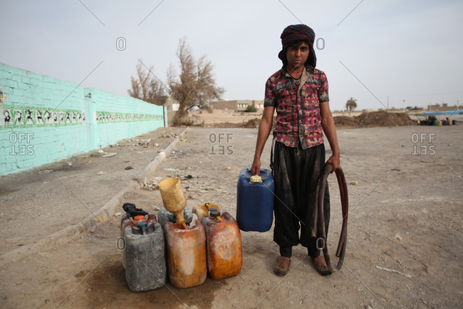 Zabol, Iran - May 1, 2014: A portrait of a man selling petrol on the street in Kabul