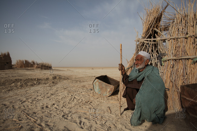 An Iranian man sitting on the ground in a village in south Iran