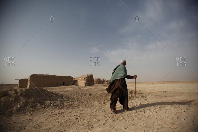 An Iranian man walking in a village in south Iran