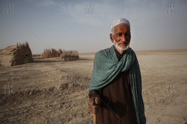A portrait of an Iranian man standing in a village in south Iran