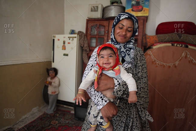 Zabol, Iran - May 4, 2014: Mother and kids at home in south Iran