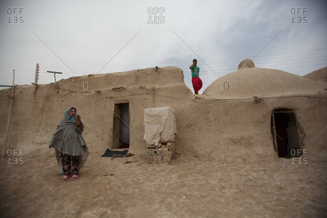 Zabol, Iran - May 2, 2014: Woman and young man in a village in south Iran