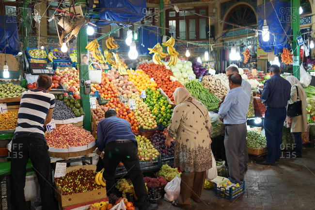 Tehran, Iran - October 3, 2015: People buying fruits at a market in north Tehran