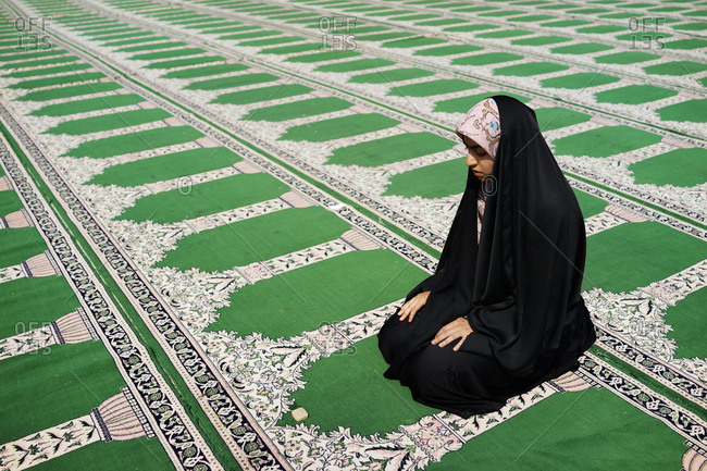 Iranian girl praying at a mosque