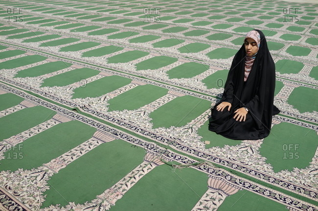 Iranian girl at a mosque by herself