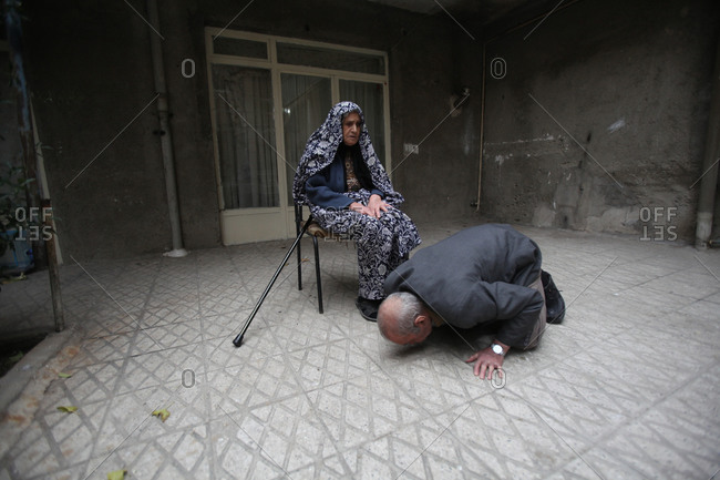 Father of martyr kissing the ground where his son's body was found