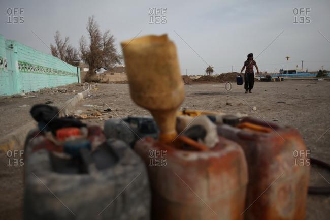 Zabol, Iran - May 1, 2014: Man selling petrol on the street in Kabul