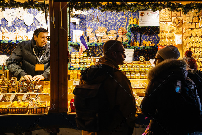 Strasbourg, France - November 28, 2015: People buying traditional Christmas souvenirs at Strasbourg Christmas market