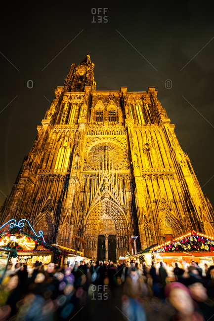 Crowds at the Christmas market in the Place de la Cathedrale with Notre Dame Cathedral in Strasbourg, France