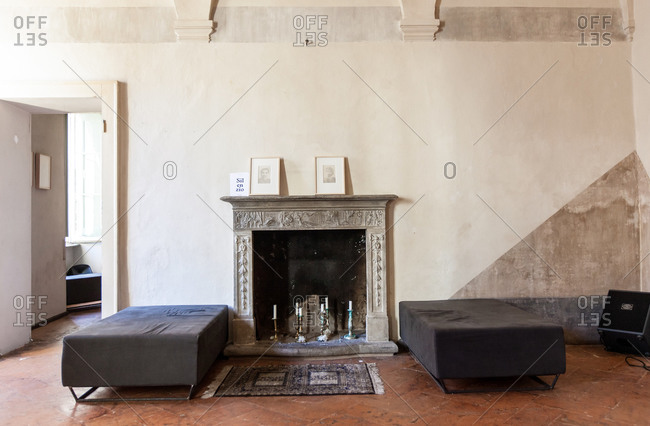 Lugano, Switzerland - September 25, 2015: Living room with fireplace in an old house