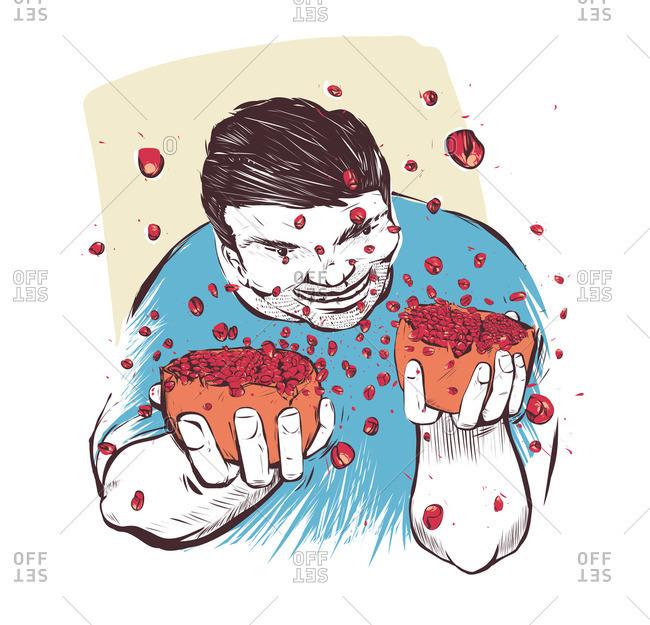 Man opening a bursting pomegranate